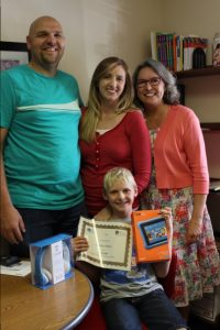 Dawson Willis (front center), with his tutor Carolee Hinterman (right), and his parents.